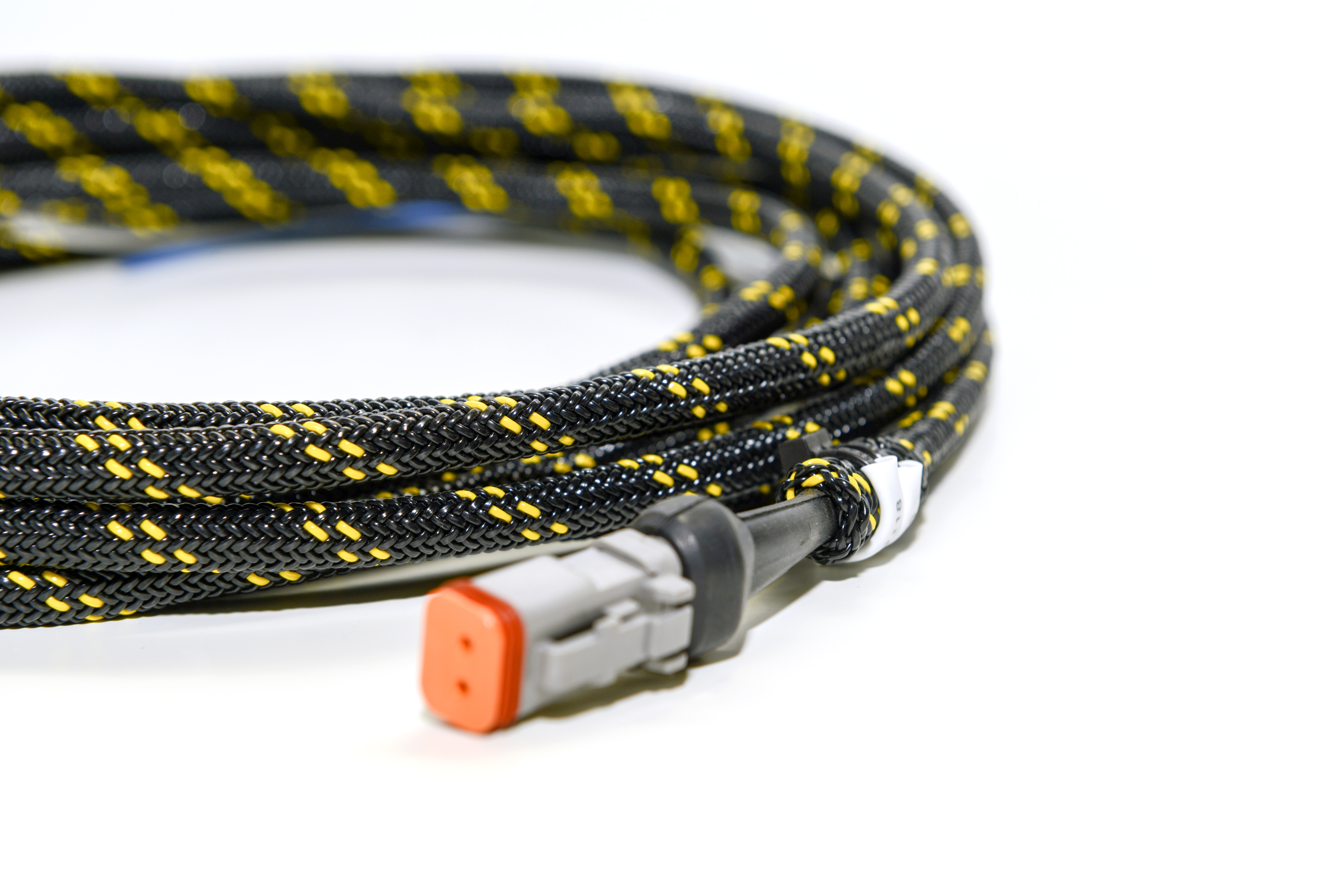 we design and manufacture automotive braided wiring harnesses that  withstand high temperatures and offer better protection and durability than  standard
